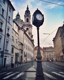 Clock in Prague. Karmelitská and St Nicholas Church Stock Images