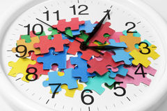 Clock and Puzzle Pieces. Composite of Clock and Puzzle Pieces Stock Photos