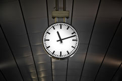 Clock in railway station Royalty Free Stock Image