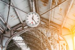 Clock at the railway station. Concept of meeting, waiting, seeing people on the road trip. stock image