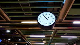 Clock in railway station Stock Photo