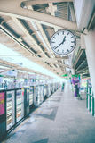 Clock at railway  station. - Vintage color tone. Royalty Free Stock Photography