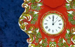 Clock on a red background with a bright floral pattern royalty free stock photo