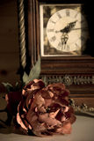 Clock and red rose Stock Photography