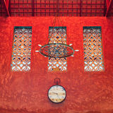 Clock on red sculture texture wall Stock Photography