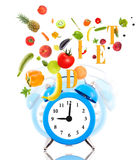Clock ringing, fruits and vegetables. Stock Images