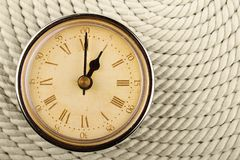 Clock with Roman numerals. One hour. Stock Photos