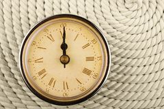 Clock with Roman numerals. Timу twelve hours. Royalty Free Stock Photography