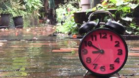 Clock running with rain drop slash in slow motion stock video footage