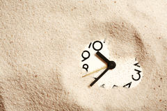 Clock In Sand Stock Images