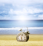 Clock in sand Royalty Free Stock Photos