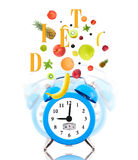 Clock, scale dial and fresh fruits Stock Photo