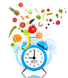 Clock, scale dial, fruits and vegetables. Stock Images