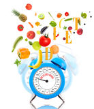 Clock, scale dial, fruits and vegetables. Stock Photos
