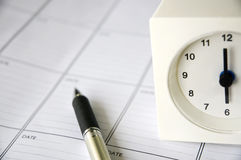 Clock on schedule planner. Clock at six o clock put on schedule planner Royalty Free Stock Images