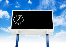 Clock score board at football stadium. With bluesky Stock Images