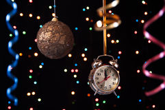 Clock,serpentine,Christmas ball on a black Royalty Free Stock Photography