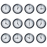 Clock set with Roman numerals, timed at each hour. Set of realistic wall clocks with Roman numerals, with the times set at every hour Stock Photo