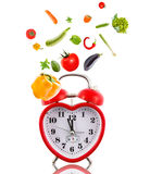 Clock in shape of heart with vegetables. Clock in shape of heart with vegetables isolated on white Royalty Free Stock Photo