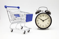 Clock and shopping cart Royalty Free Stock Images