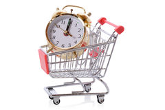Clock in shopping tolley Stock Photo