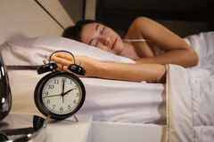 Clock show 2 O`clock and woman sleeping on bed. Clock show 2 O`clock and woman sleeping on the bed royalty free stock photography