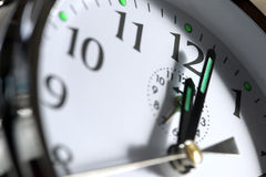 Clock showing 12 o'clock Royalty Free Stock Photos