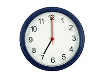 Clock showing 7 o'clock Royalty Free Stock Image