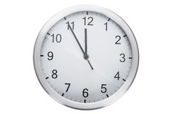 Clock showing five minutes to twelve Royalty Free Stock Photos