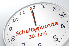 A clock showing leap second at june 30 in german language Stock Photography