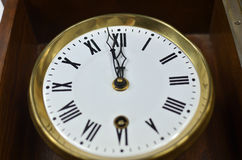 Clock Showing Noon or Midnight. Clock in retro style showing noon or midnight Stock Photos