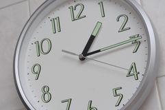 Clock showing one-fifteen time Royalty Free Stock Photography