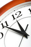 Clock showing time about twelve isolated Stock Images