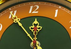The clock shows the time of eleven hours and fifty-five minutes. The clock shows eleven hours and fifty-five minutes Royalty Free Stock Photography