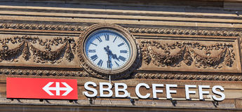 Clock and the sign of the Swiss Federal Railways on the facade o Stock Image