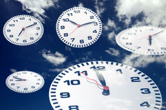 Clock with sky Stock Photos