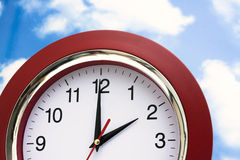 Clock in Sky Stock Images