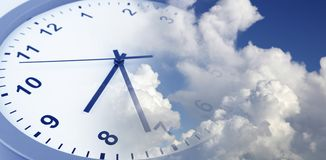 Clock in sky. Clock face in blue sky. Time passing Royalty Free Stock Photography