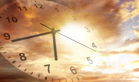 Clock in sky. Clock face in bright sky. Time passing Royalty Free Stock Photo