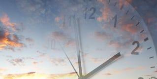Clock in sky. Clock face in bright sky. Time passing Stock Photo