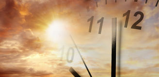 Clock in sky. Clock face in bright sky. Time passing Royalty Free Stock Image