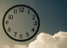 Clock and sky. Clock with no hands   on blue vintage  sky Stock Photos