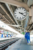 Clock on the sky train terminal Stock Photography