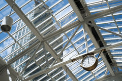 Clock  skylight and skyscraper Royalty Free Stock Photo