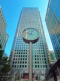 A clock and skyscrapers Stock Photo