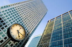 Clock and skyscrapers at Canary Wharf, London, UK Royalty Free Stock Images