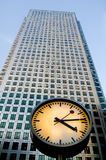Clock and skyscrapers at Canary Wharf, London, UK Stock Photo