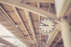 Clock in skytrain staion in bangkok, Thailand Stock Photo