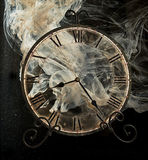 Clock in smoke Royalty Free Stock Photo