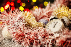 Clock in snow-covered Christmas ornaments Royalty Free Stock Photography